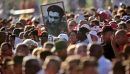 People in Cuba carry a portrait of Che during an act to commemorate the 50th anniversary of his death.